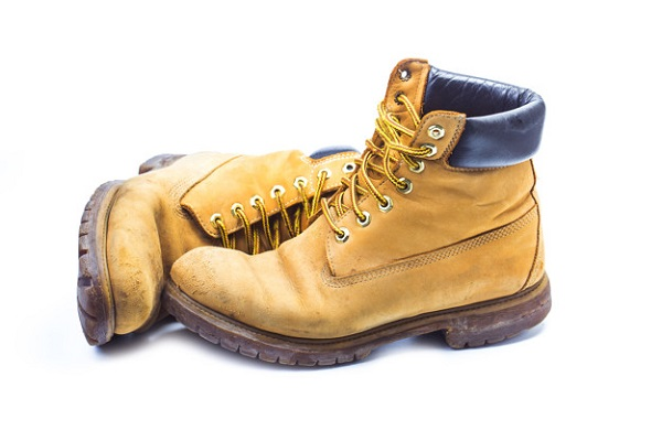 Pair of old yellow working boots,Nostalgic